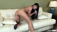 Buxom brunette Eva Karera shows off her butt and starts toying her twat