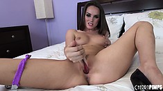 Beautiful babe Tori Black shows off her cute tits, spicy ass and her passion for dildos