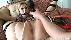 Adrianna Nicole gets folded in half and taped up then stuffed with toys