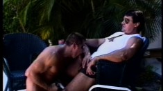 Muscled studs take turns blowing each other's hard pricks outside